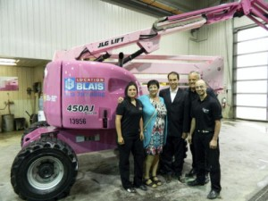 JLG dealer Location Blais painted a JLG 450AJ articulating boom lift pink to raise breast cancer awareness. Standing beside the lift are, from left to right, Christina Bolduc, Denise Racette, breast cancer patient and mother of Serge Blais, Serge Blais, Jr., Location Blais owner, Marc Blais, Location Blais president and general manager, and Olivier Gauthier, development officer with the Canadian Cancer Society's Quebec Division.